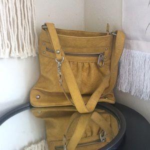 Carlos Santana mustard yellow shoulder bag